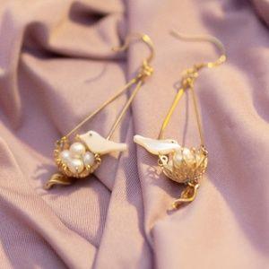 gold plated bird nest dangling drop earrings